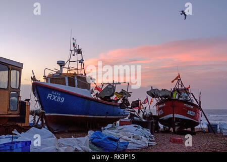 Hastings, East Sussex, UK. 9th February 2019. Fishing boats at dawn on the Stade Fishing Boat beach, on a mild blustery day. Carolyn Clarke/Alamy Live News - Stock Image