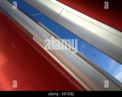Abstraction of steel, red, sky and bird - Stock Image