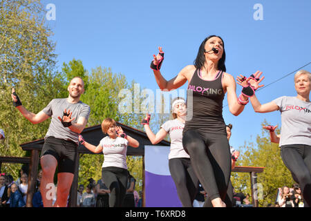 Nis, Serbia - April 20, 2019 People participating in the free public Piloxing class in summer at park - Stock Image