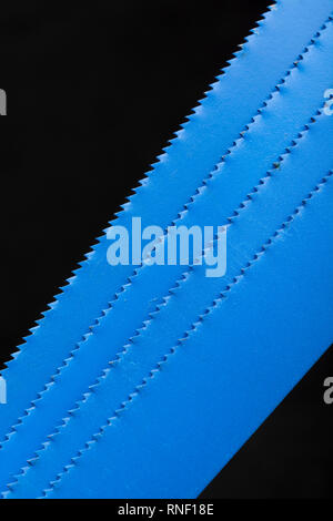 Macro photo of blue metal hacksaw blades / 24TPI. - Stock Image