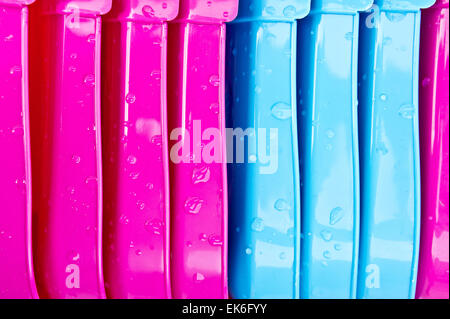 Pink and blue plastic tubs as a background image - Stock Image