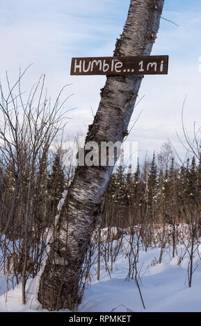 A wooden sign nailed to a tree trunk directing to Humble. Duluth, Minnesota, USA. - Stock Image
