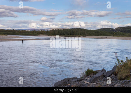 One person fishing in Alta river during early fall day. - Stock Image