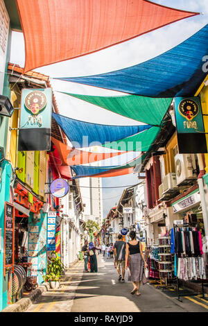 Singapore - 22nd December 2018: Tourists walking in Haji Lane. This is in the Kampong Glam area - Stock Image