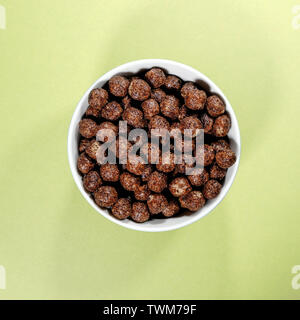 Bowl of Nesquik Chocolate FLavoured Breakfast Cereals Isolated High Angle Shot - Stock Image