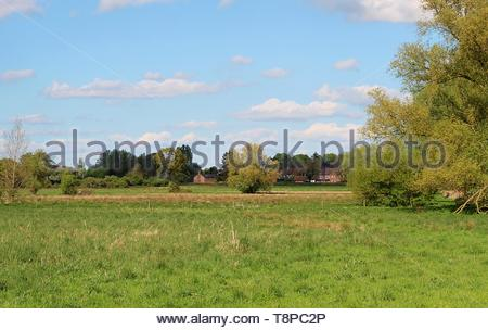 a view across the Suffolk countryside with a village nestled in the distance - Stock Image