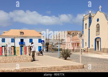 Scene in main square with cobbled street and catholic Church of St Isobel. Largo Santa Isobel, Sal Rei, Boa Vista, Cape Verde Islands, Africa - Stock Image