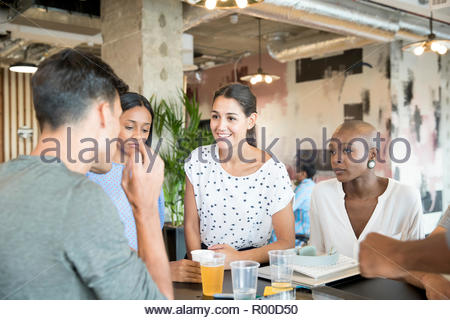 Colleagues having drinks - Stock Image