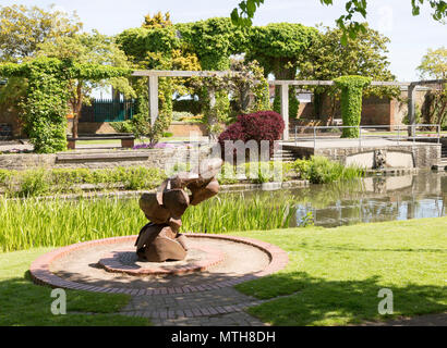 Sculpture water feature and gardens in Queen's Park, central Swindon, Wiltshire, England, UK - Stock Image
