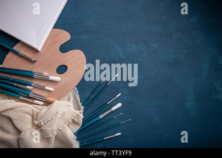 Artistic equipment concept on blue background with space for your text - Stock Image