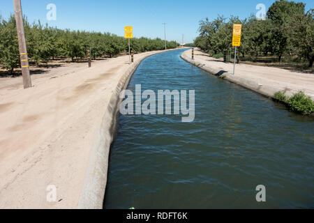 Agricultural aqueduct for irrigation on California central valley farm land - California, USA - Stock Image