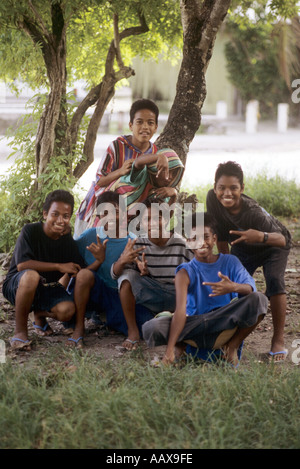 Marshall Islands Kids making American style gangster signs - Stock Image
