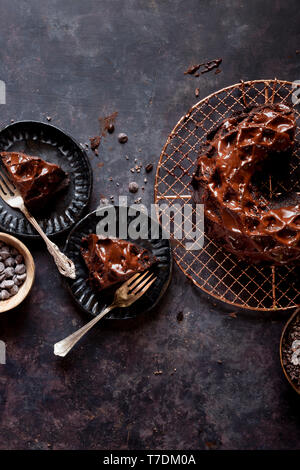 Gluten-free Chocolate Budnt cake with chocolate drizzle. - Stock Image