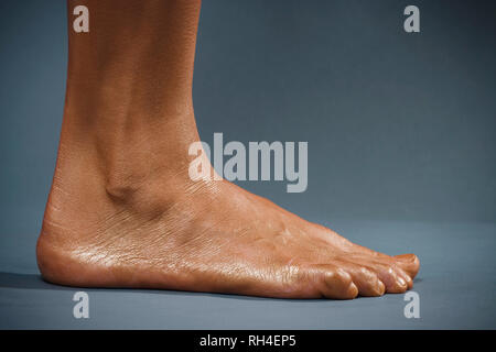 Close up oiled, moisturized barefoot of woman - Stock Image