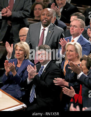 February 5, 2019 - Washington, District of Columbia, U.S. - The audience applauds as United States President Donald J. Trump delivers his second annual State of the Union Address to a joint session of the US Congress in the US Capitol in Washington, DC on Tuesday, February 5, 2019. Pictured top row, from left to right: US Senator Pat Roberts (Republican of Kansas), US Senator Tim Scott (Republican of South Carolina), and Acting White House Chief of Staff and Director of the Office of Management and Budget (OMB) Mick Mulvaney. Pictured lower row, from left to right: US Secretary of Education B - Stock Image