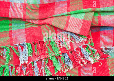 Red and green tartan blanket - Stock Image