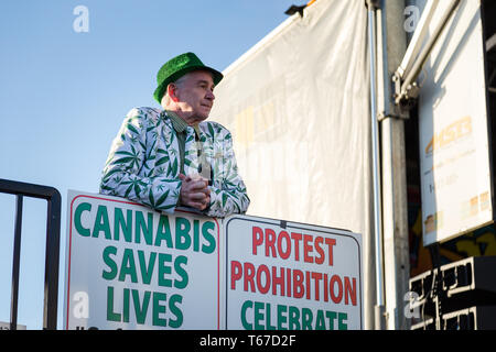 VANCOUVER, BC, CANADA - APR 20, 2019: A marijuana activist standing by a pro-marijuana sign at the 420 festival in Vancouver. - Stock Image