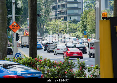 Heavy traffic on Orchard Road in central Singapore - Stock Image