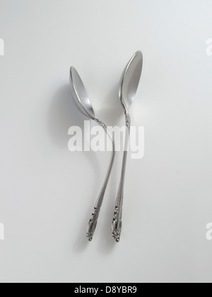 two side-by-side spoons - Stock Image