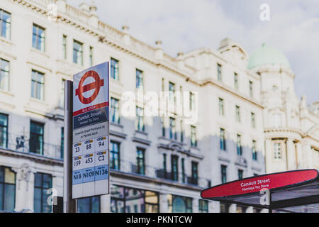 LONDON, UNITED KINGDOM - August 13th, 2018: Conduit Street bus stop in London city centre - Stock Image