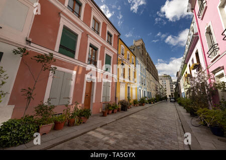 Rue Crémieux is hidden between Rue de Lyon and Rue de Bercy, and can be quickly missed. Most of the houses are painted in a variety of pastel colours, - Stock Image
