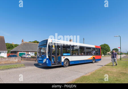 Number 9 Stagecoach single deck bus in a residential area in Rustington, West Sussex, England, UK. - Stock Image