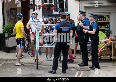 Suffolk PCSOs showing interest in a bicycle built for four - Stock Image