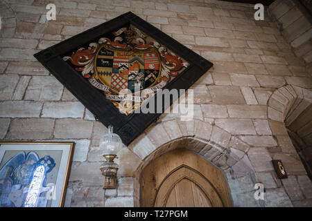 Lindisfarne or Holy Island, Northumberland coast south of Berwick-on-Tweed, England. Parish church of St Mary the Virgin. Askew Family hatchment. - Stock Image