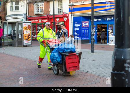 Biffa street cleaner collecting waste bags, ashford, kent, uk - Stock Image
