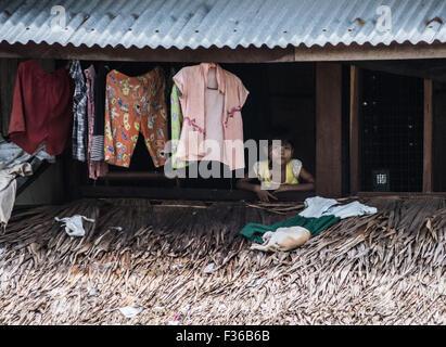 Girl in her home in rural Myanmar - Stock Image