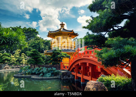 Front view the Golden pavilion temple with red bridge in Nan Lian garden, Hong Kong. Asia. - Stock Image
