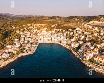 Skala Marion beach and harbour in Thasos Island, Greece. Sunset view shot using a drone - Stock Image