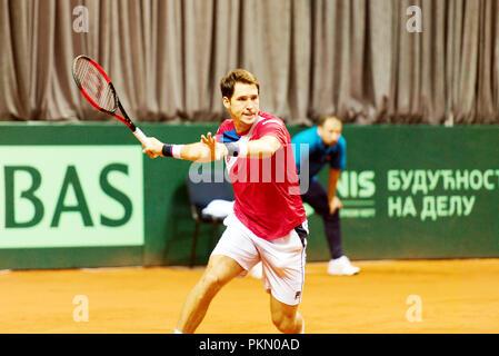 Kraljevo, Serbia. 14th September 2018. Dusan Lajovic of Serbia in action in the second singles match of the Davis Cup 2018 Tennis World Group Play-off Round at Sportski Center Ibar in Kraljevo, Serbia. Credit: Karunesh Johri/Alamy Live News. - Stock Image