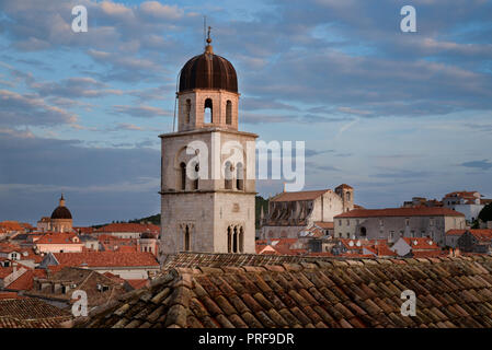 The Bell Tower of the Franciscan Monastery with Saint Ignatius Church beyond, Old Town of Dubrovnik, Croatia - Stock Image