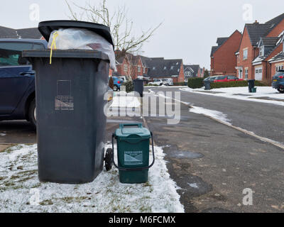 Ashourne, Derbyshire. 3rd March 2018. UK Weather: overflowing bins from Thursday awaiting collection by Derbyshire - Stock Image