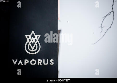 MONTREAL, CANADA - NOVEMBER 5, 2018: Vaporus logo on their main shop for Montreal. Vaporus is a franchise selling electronic cigarettes and e juice li - Stock Image