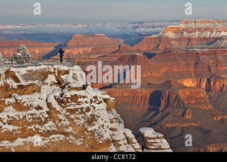 Photographer on canyon rim, winter view at Mather Point, South Rim of Grand Canyon National Park, Arizona, USA, - Stock Image