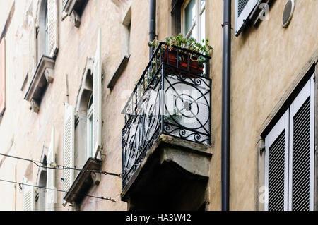 A traditional Italian wrought iron balcony in Citta Alta, Bergamo, Italy - Stock Image
