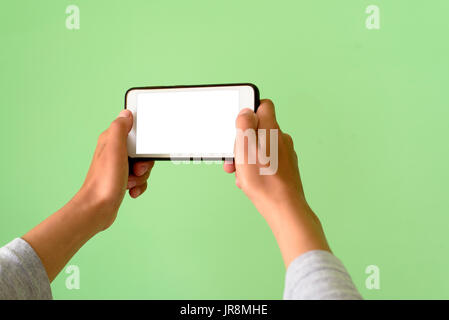 Woman holding a Smart Phone device with clipping path for VR augmented reality overlay - Stock Image
