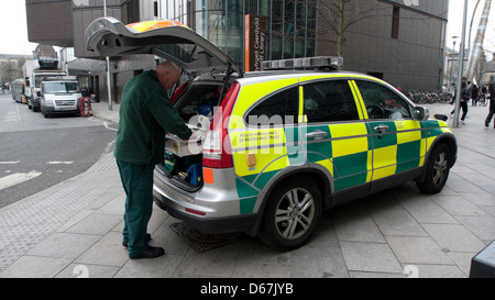 A Welsh NHS worker and  A & E paramedic ambulance car in Cardiff City Centre Wales UK  KATHY DEWITT - Stock Image