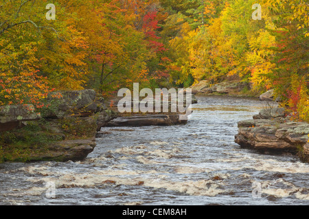 Autumn colors along the Kettle River at Banning Rapids in Banning State Park, Sandstone, Minnesota, USA - Stock Image