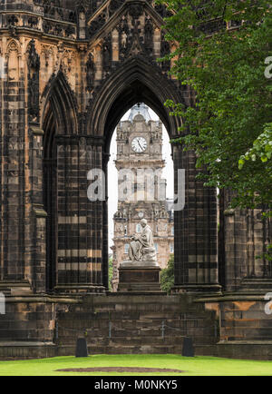 The Scott Monument, with statue and the clock tower of the Balmoral Hotel in the background viewed through the monument, - Stock Image