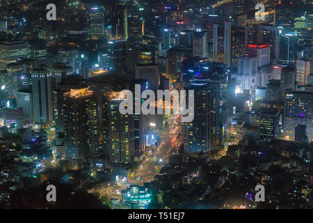 Aerial view of urban skyscrapers lighted at night, Seoul, South Korea - Stock Image