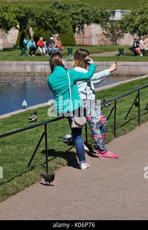 Two girls taking selfies, Peterhof, near St. Petersburg, Russia - Stock Image