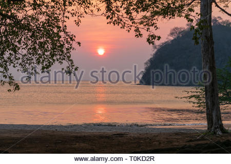 Sun setting over the Pacific Ocean on the east coast of Costa Rica, in the Guanacaste province - Stock Image