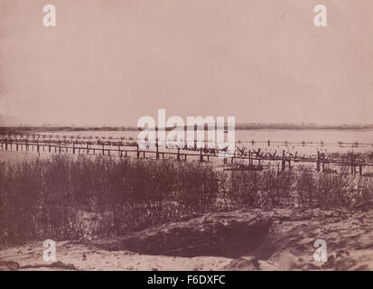 WW2 Normandy sea defences of barbed wire and sea mines. - Stock Image