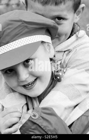 Hug/playing kids in the gypsy camp - Stock Image