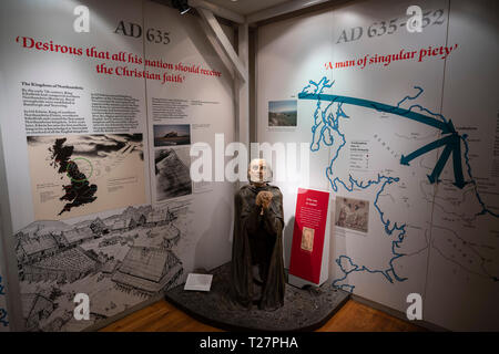 Lindisfarne or Holy Island, Northumberland coast south of Berwick-on-Tweed, England. In the visitor centre museum. Exhibit of St Aidan's life. - Stock Image