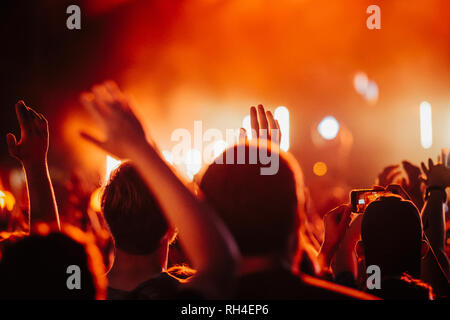 Crowd watching concert and cheering - Stock Image