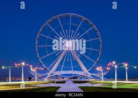 View of the Baku ferris wheel from Dugustu Park, Baku, Azerbaijan - Stock Image